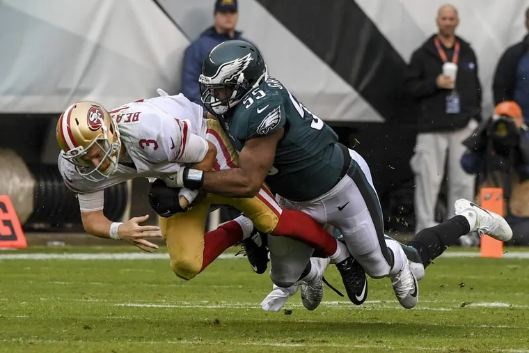 Eagles defensive end Brandon Graham tackles San Francisco 49ers quarterback C.J. Beathard after a scramble.