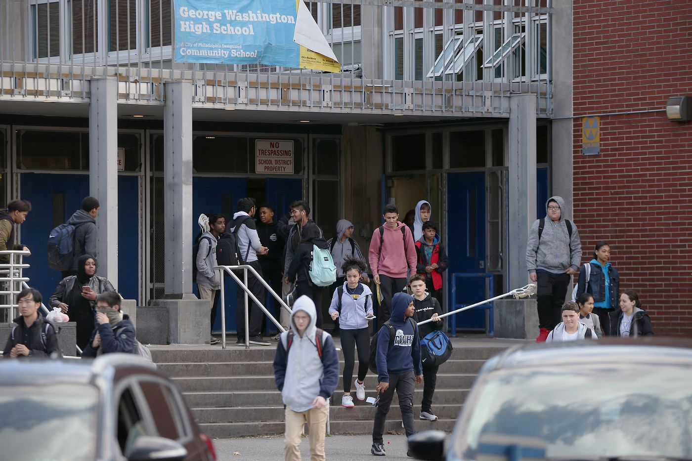 Students leave George Washington High School in Northeast Philadelphia after dismissal on Friday, March 13, 2020. Philadelphia public schools will be closed for two weeks due to staffing shortages resulting from the coronavirus, Superintendent William Hite announced Friday.