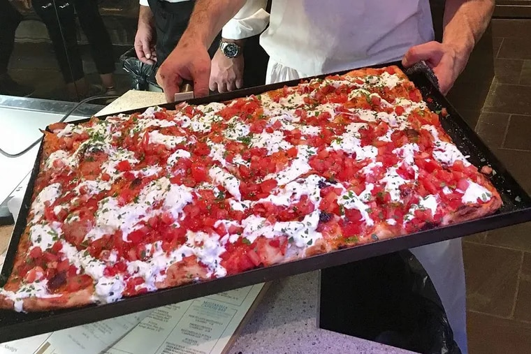 Pizza al taglio from Alice is cut from sheets.