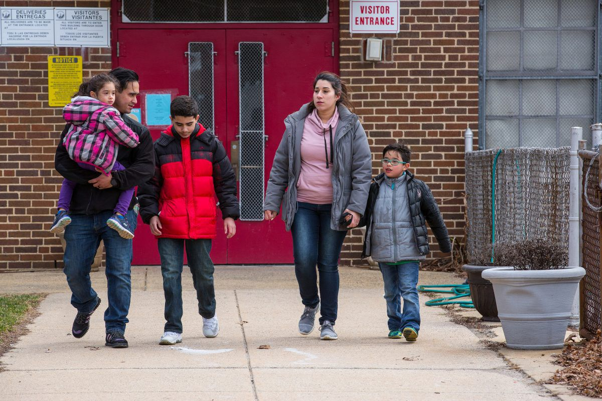 (Left to Right) Four-year-old Eliana, David Pagan, eleven-year-old Johan, Cristine Gonzalez, and six-year-old Dean, shown here at one of the entrances of Dean's school, Comly Elementary School. Dean suffers from severe lead poisoning.