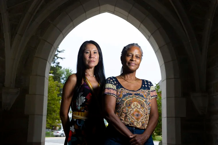Bessie Lawton, left, and Anita Foeman, professors at West Chester University, recently wrote a book about how DNA test results can shape people's identities and personal narratives, based on their ongoing research project with WCU students.  They are shown on the campus of West Chester University on Aug. 31, 2021.
