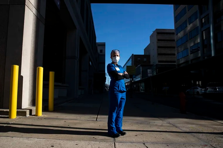 ICU nurse Mary Adamson posed for a portrait on Broad Street outside of the Temple University Hospital in Philadelphia, Pa. on Tuesday, December 15, 2020.