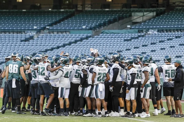 The Eagles gather before the start of practice at the Angles Stadium of Anaheim in Anaheim, California on Thursday, December 7, 2017. YONG KIM / Staff Photographer