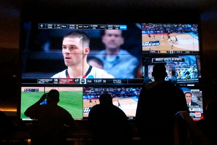 Customers watch a game during the NCAA March Madness college basketball tournament at the Hard Rock casino in Atlantic City on March 22. Casinos in eight states are opening or expanding retail sportsbooks to capture in-person sports betting business, even while most of the growth in the new industry is forecast to be online.