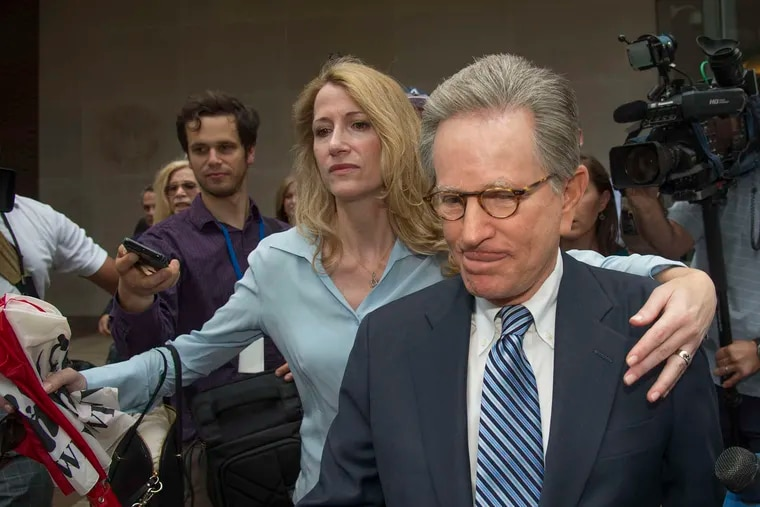 In a file photo, niece Jaclyn Savitz clears the way as Herbert Vederman leaves the federal courthouse in Philadelphia on June 21, 2016, after being convicted, along with his friend U.S. Rep. Chaka Fattah, of bribery. Those convictions were overturned on appeal last year.