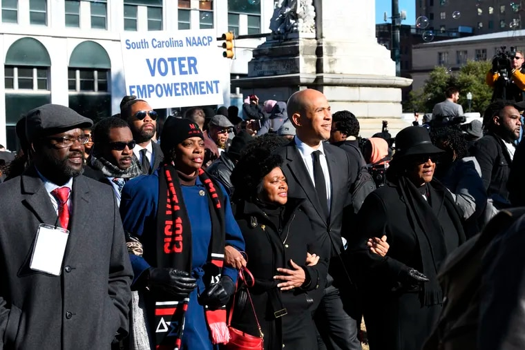 Sen. Cory Booker (D., N.J.) walks with South Carolina NAACP president Brenda Murphy during a Martin Luther King Jr. Day march and rally in Columbia, S.C. on Jan. 14. Booker's presidential campaign may hinge on a strong showing in South Carolina, one of the few states were African Americans make up the majority of the Democratic electorate.