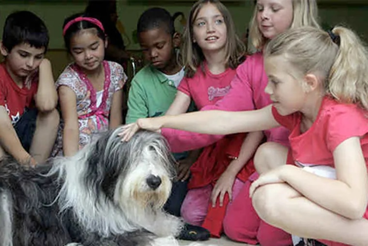 At Good Intent Elementary in Deptford, Henley the rescue mascot with fans (from left) Zachary Rosenzweig, Jamie Megina, Christopher Pichardo, Carla Hansen, Samantha Kiermeler, and Samantha Thomas. Students helped contribute to Gloucester County Animal Shelter. (Bonnie Weller / Staff Photographer)