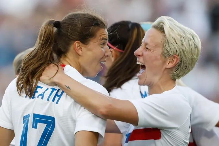 U.S. women's soccer team stars Tobin Heath (left) and Megan Rapinoe right).