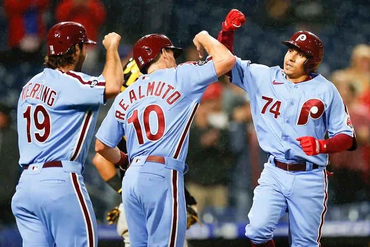 Phillies Ronald Torreyes celebrates his three run home run with teammates J.T. Realmuto and Matt Vierling.