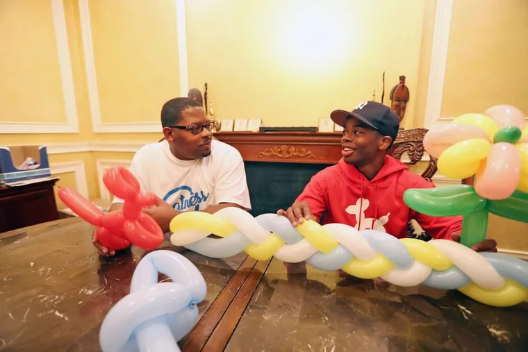 Local balloon artist Brian Ward and his father in the dining room of their Philadelphia home Tuesday November 14, 2017. DAVID SWANSON / Staff Photographer