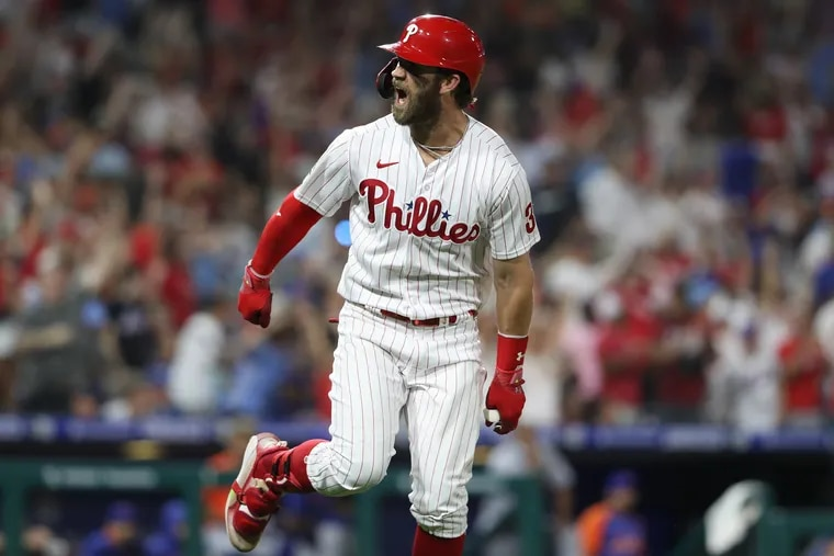 Bryce Harper of the Phillies celebrates after hitting his big 2-run home run in the 8th inning.