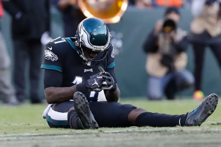 Eagles wide receiver Alshon Jeffery sits on the turf after dropping a pass against the Chicago Bears.