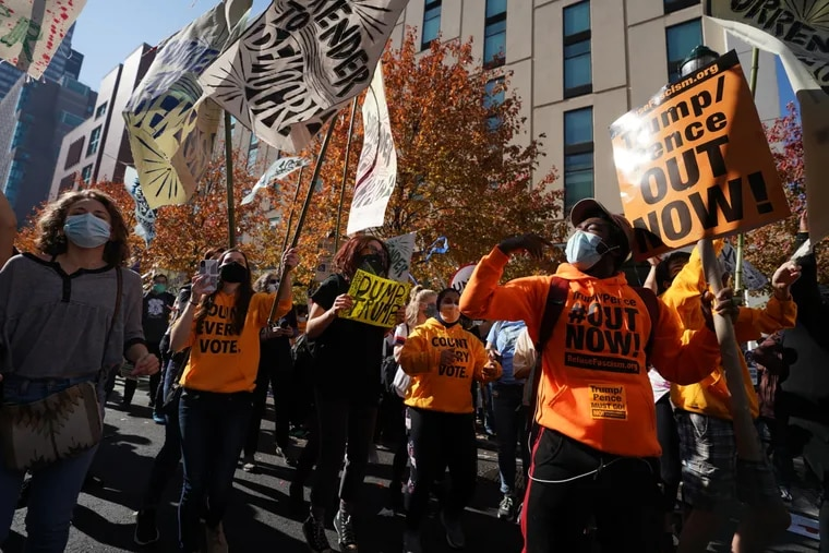 Demonstrators on Friday outside the Pennsylvania Convention Center in Philadelphia, where the city's votes are being tallied and where people have rallied in support of counting every vote.