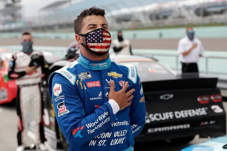 Bubba Wallace stands for the national anthem before a NASCAR Cup Series auto race last Sunday n Homestead, Fla.