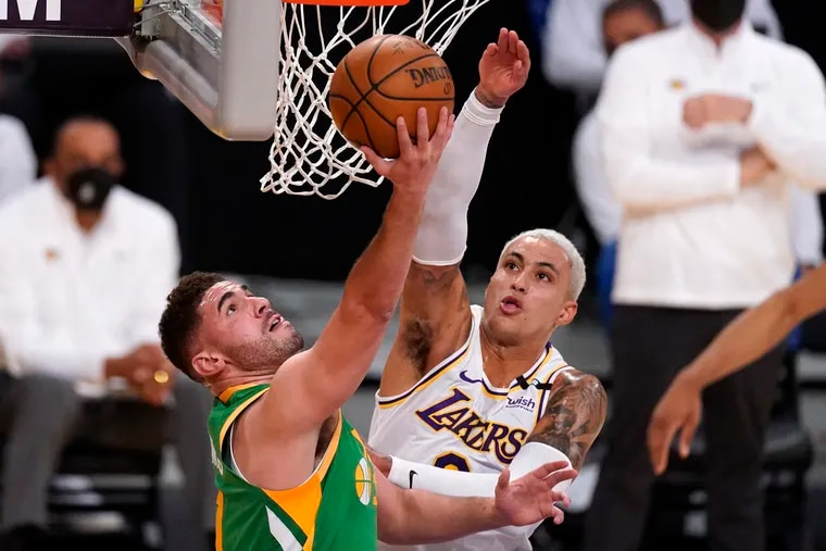 Utah Jazz forward Georges Niang shoots as Los Angeles Lakers forward Kyle Kuzma defends in April.