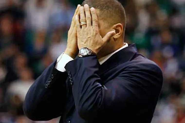 Eddie Jordan covers his face after an official's call during the first half Sixers loss to the Jazz last night. (AP Photo/Steve C. Wilson)