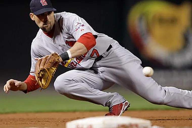 Cardinals third baseman Mark DeRosa is one of the Phillies' targets to potentially replace Pedro Feliz. (Al Behrman/AP file photo)