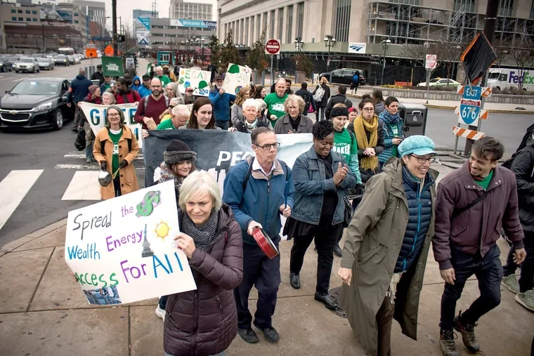 Members of the Earth Quaker Action Team (EQAT) march on Peco Energy headquarters in a protest that's part of its ongoing campaign for solar energy and green jobs.