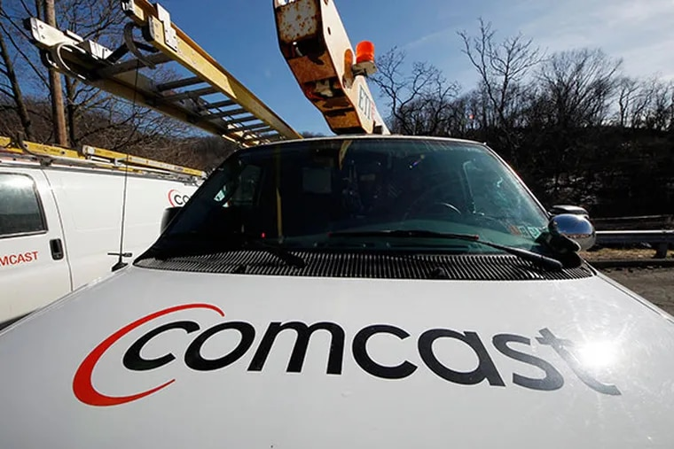 A Comcast truck is parked in Pittsburgh. (AP Photo/Gene J. Puskar, File)