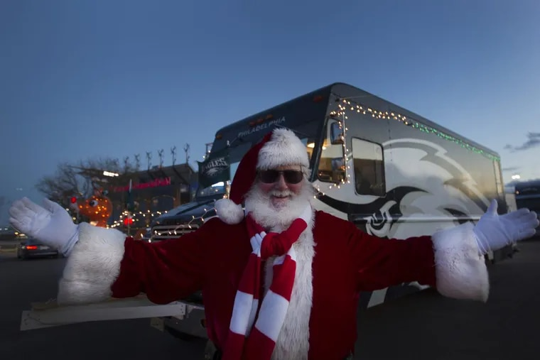 Fran Mulherin, of Williamstown, N.J., an  Eagles fan who calls himself Franta Claus,  smiles outside Lincoln Financial Field in Philadelphia before the game against the Oakland Raiders on Christmas Day,  Monday, December 25, 2017.