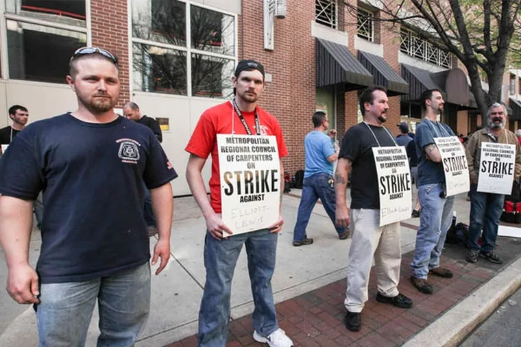 Carpenters union on strike. The union and the Teamsters were the only two not to sign an agreement with the Convention Center. (Steven M. Falk / Staff Photographer)