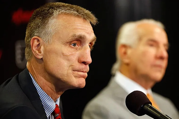 Paul Holmgren, left, listens to a reporter's question as chairman Ed Snider looks on during an NHL hockey news conference, Wednesday, May 7, 2014, in Philadelphia. (Matt Slocum/AP)