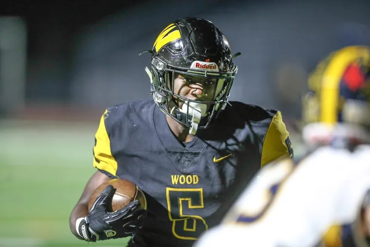 Archbishop Wood's Nasir Peoples gets past Unionville's James Hower for a touchdown during the first quarter in PIAA Class 5A semifinals at Northeast High on Friday.
