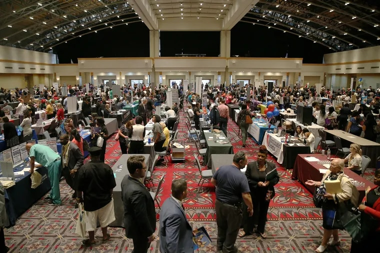 People talk to employers during a job fair at the Pennsylvania Convention Center in Center City Philadelphia on Thursday, July 25, 2019. Conference organizers are canceling events as the new coronavirus spreads across the country, including in the Philadelphia regon.