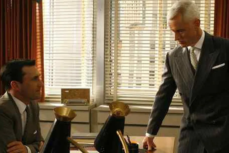 "John Hamm (left) and Roger Slattery in a scene from AMC's ""Mad Men"": Getting more ads."