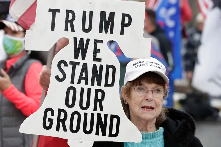 A supporter of President Donald Trump attends a rally at Freedom Plaza, Saturday, Dec. 12, 2020, in Washington.