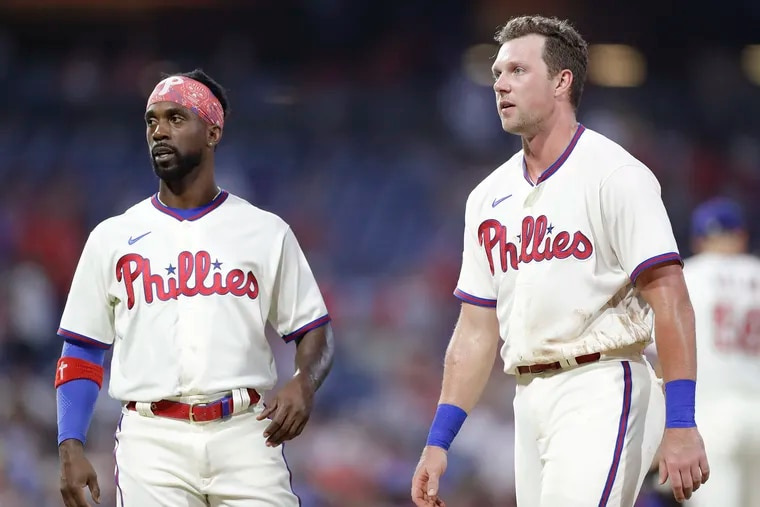 Phillies left fielder Andrew McCutchen (left) likely will return from the injured list Wednesday. But first baseman Rhys Hoskins (right) will be out until at least next week.