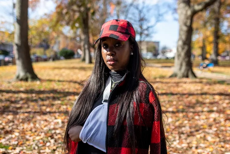 Rickia Young, 28, of North Philadelphia at Malcolm X Park in West Philadelphia on Nov. 14, 2020. Young, her 2-year-old son and 16-year-old nephew were driving home when she encountered police from a night of protests. The city said Monday it settled with her for $2 million.