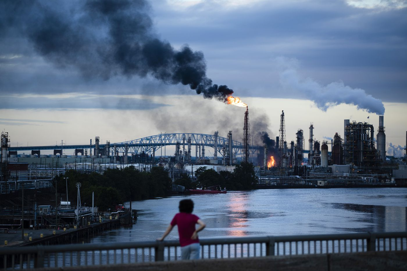 Flames and smoke emerge from the Philadelphia Energy Solutions Refining Complex in Philadelphia, Friday, June 21, 2019. Explosions and a blaze at the largest oil refinery on the East Coast shook homes before dawn Friday, though authorities reported only a few minor injuries and said the air was safe to breathe. (AP Photo/Matt Rourke)