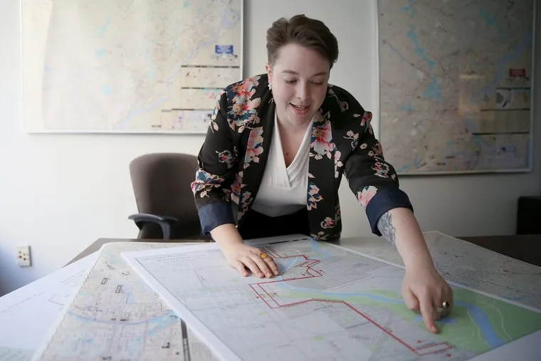 SEPTA operations planner Anita Davidson looking over the proposed 49 bus route at the authority's headquarters in Center City.