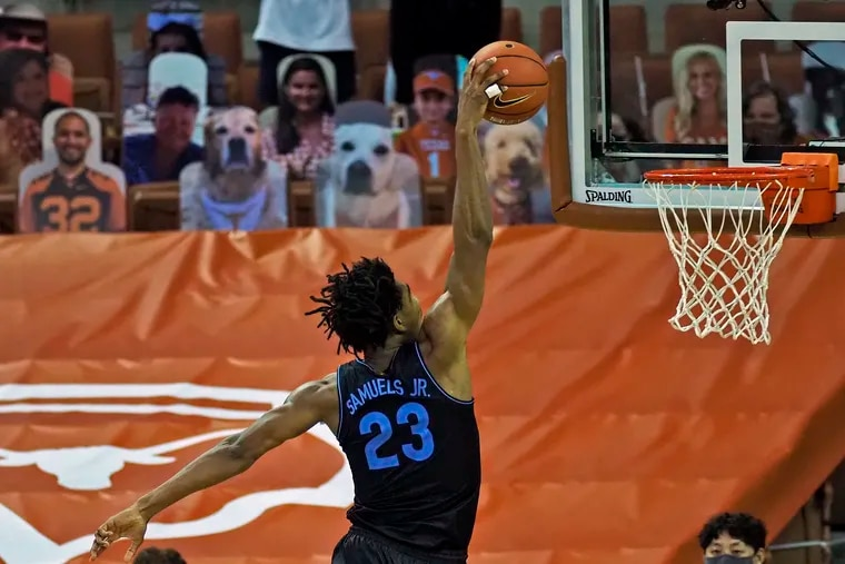 Villanova forward Jermaine Samuels goes up for a dunk during the second half.