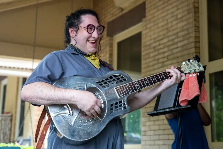 Dot Levine, of Dottie's Serenade Service, opens up the performance with a Happy Birthday song to Michael Williams, who was celebrating his 70th birthday at his home in West Philadelphia on Friday, July 24, 2020.