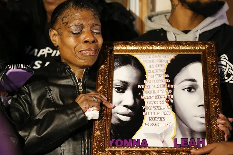 Sharon Hopkins, grandmother of Tiyaniah Hopkins and Yaleah Hall, cries while holding their photograph during a vigil in North Philadelphia on Thursday, November 29, 2018. Tiyaniah Hopkins, Yaleah Hall and two men were shoot during a drug deal that turned into an armed robbery in Southwest Philadelphia last week. A suspect was captured and arrested.