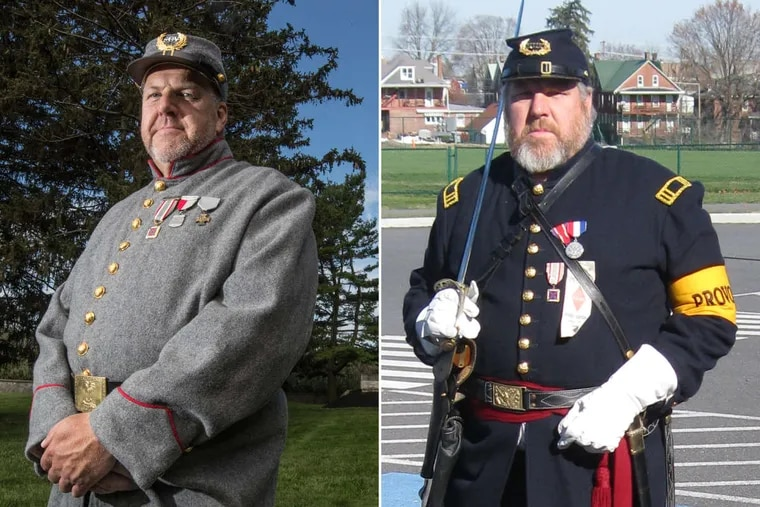 David Hann, commander of the New Jersey chapter of the Sons of Confederate Veterans, stands in his replica Confederate, left, and Union, right, uniforms.