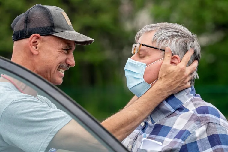 Greg Ogrod (left) embraces his brother, Walter Ogrod, on Friday at Wawa on Skippack Pike in Schwenksville. Walter Ogrod has been on death row for 23 years and incarcerated for 28 years, and he appeared at Wawa to meet family and friends immediately after his conviction was vacated.