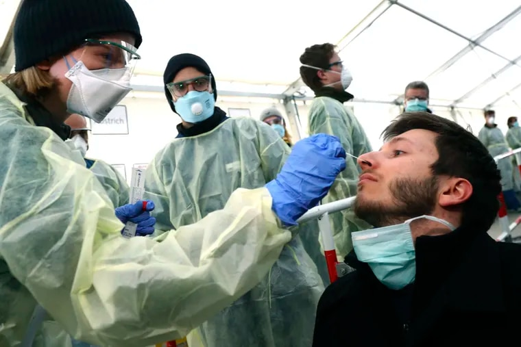 Medical employees last week demonstrated testing, at a coronavirus test center for public service employees, during a media presentation in Munich, Germany.