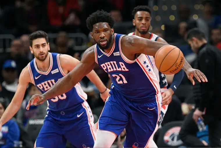 Joel Embiid chases a loose ball in the first half of the Sixers' loss to the Wizards in Washington on Thursday.