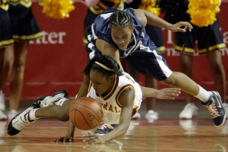 Point guard, Najah Jacobs, bottom, goes after the loose ball. Jacobs and the Lancers girls' basketball team aspire to regain the city crown. (Yong Kim / Staff Photographer)