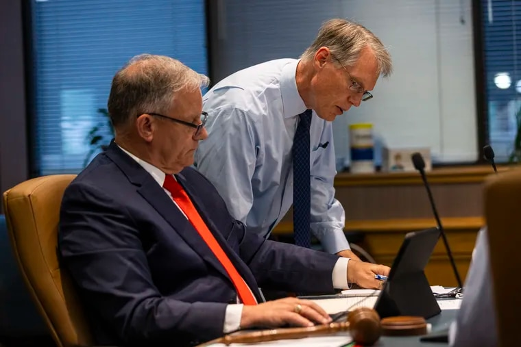 James H. Grossman Jr. (right), the investment chief for the PSERS pension fund, goes over issues with the fund's board chairman, Christopher Santa Maria at a June meeting. Grossman and other members of his investment team recently updated their financial disclosures.