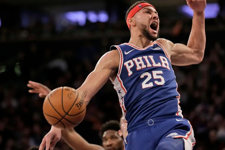 Ben Simmons celebrates a first-half dunk during the Sixers' win on Sunday.