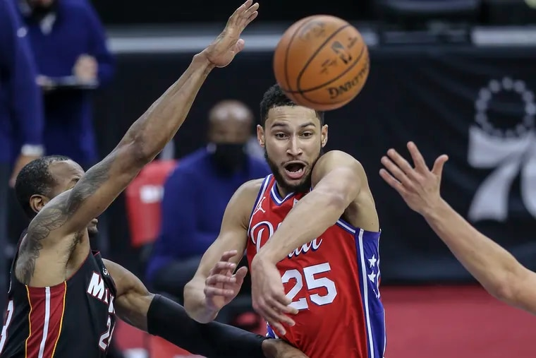 Ben Simmons throws a pass by the Heat's Andre Iguodala during the second quarter of Thursday's 125-108 win. He recorded 10 points, 10 rebounds, 12 assists and three steals.