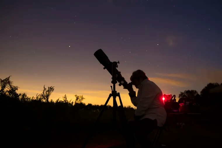 Bea Mazziotta of Broomall, PA at a telescope during a stargazing event with the Chester County Astronomical Society at the Bucktoe Creek Preserve in Avondale, PA on Sept. 29, 2018. Clouds moved in to cause an early end to the evening.
