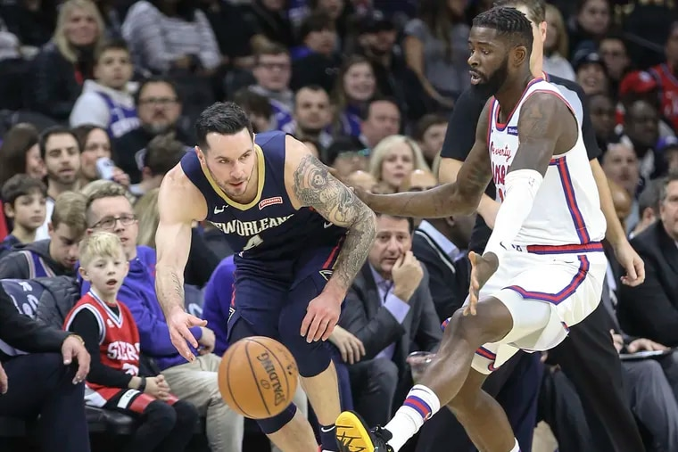 The Sixers' James Ennis III watches the Pelicans' JJ Redick go for the loose ball during the first quarter at the Wells Fargo Center on Friday.