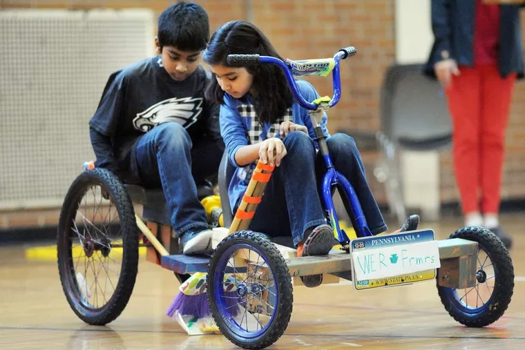 From left, Thomas Cherian and Heeya Jagirdar of Afton Elementary School ride on a tricycle the demonstrations their solution to No-Cycle Recycle during the Southeast Pennsylvania Odyssey of the Mind tournament Saturday February 27, 2016 at Pennsbury High School West in Fairless Hills, Pennsylvania.