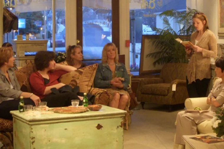 """Author Kelly Simmons reading from her book, """"Standing Still,"""" to a book group at Origin & Ash furniture store in Bryn Mawr."""