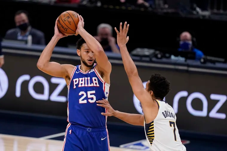 The 76ers' Ben Simmons (25) is defended by Indiana Pacers' Malcolm Brogdon (7) during Friday's preseason game.